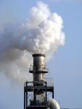 Air Pollution. Smoke from chimney polluting the air Stock Photos