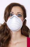 Air Pollution Advisory. Young attractive woman responds to an air quality pollution advisory Stock Photography