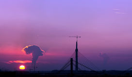 Air pollution in Belgrade Serbia. Smoke rises at sunset in Belgrade Serbia during construction of new bridge photo: Pedja Milosavljevic Royalty Free Stock Photo