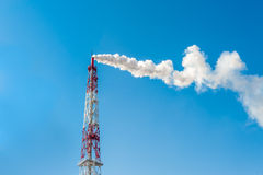 Air pollution chimney factory with smoke against blue sky Royalty Free Stock Photography