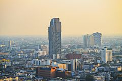 Air pollution in the city. Bangkok Thailand Center and modern skyscraper city in misty gold lighting sunset air pollution in the city behind pollution haze stock images