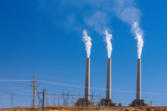 Air pollution from coal-powered plant smoke stacks Stock Photos