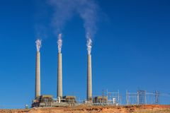 Air pollution from coal-powered plant smoke stacks Royalty Free Stock Photography
