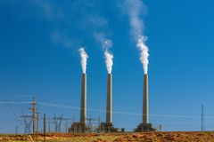 Air pollution from coal-powered plant smoke stacks Royalty Free Stock Photos