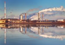 Air pollution coming from factory smoke stacks Royalty Free Stock Images