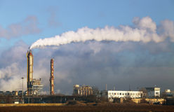 Air pollution coming from factory smoke stacks Stock Photography