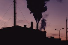 Air pollution concept. Old power plant in a night Stock Photo