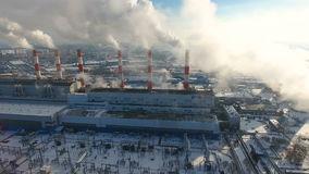 Air pollution concept. Power plant with smoke from chimneys. Drone shot.