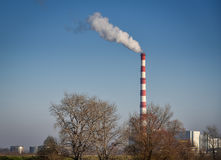 Air pollution. Factory chimney smoke destroying the nature Stock Photography