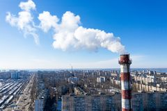 Air pollution, factory pipes, smoke from chimneys on sky background. Concept of industry, ecology, steam plant, heating season,. Global warming. Factory chimney royalty free stock photography