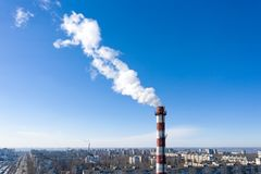 Air pollution, factory pipes, smoke from chimneys on sky background. Concept of industry, ecology, steam plant, heating season,. Global warming. Factory chimney stock photography