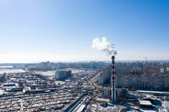 Air pollution, factory pipes, smoke from chimneys on sky background. Concept of industry, ecology, steam plant, heating season,. Global warming. Factory chimney royalty free stock image