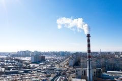 Air pollution, factory pipes, smoke from chimneys on sky background. Concept of industry, ecology, steam plant, heating season,. Global warming. Factory chimney stock image