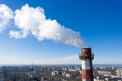 Air pollution, factory pipes, smoke from chimneys on sky background. Concept of industry, ecology, steam plant, heating season,. Global warming. Factory chimney stock photo