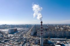 Air pollution, factory pipes, smoke from chimneys on sky background. Concept of industry, ecology, steam plant, heating season,. Global warming. Factory chimney stock photos