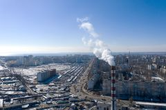 Air pollution, factory pipes, smoke from chimneys on sky background. Concept of industry, ecology, steam plant, heating season,. Global warming. Factory chimney royalty free stock images