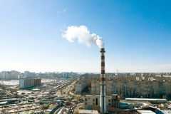 Air pollution, factory pipes, smoke from chimneys on sky background. Concept of industry, ecology, steam plant, heating season,. Global warming. Factory chimney royalty free stock photo
