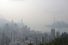 Air pollution hangs ove Hong Kong from Sir Cecil's Ride Royalty Free Stock Image