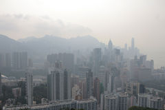 Air pollution hangs ove Hong Kong from Sir Cecil's Ride Stock Photo