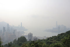 Air pollution hangs ove Hong Kong from Sir Cecil's Ride Royalty Free Stock Images