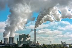 Panorama of a distant industrial plant with huge amounts of smoke stock images