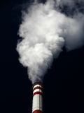 Air pollution, Massive white smokes factory. Air pollution, Massive white smokes coming out of factory chimney Royalty Free Stock Photos