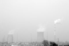 Air pollution off city. A picture taken off a city,white somke belchs from big chimney .This picture is blackwhite Royalty Free Stock Images