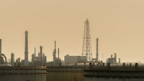 Air pollution at oil petroleum refinery plant. Bad air quality filled with dust. Global warming from air pollution problem. Environmental problem from gas stock image