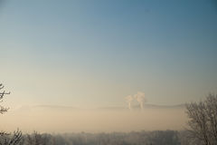 Air pollution over the city. Smoke from an industrial pipe Stock Photos