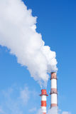 Air pollution. Pipe plant emit white smoke from the burning of fossil fuels Stock Photo