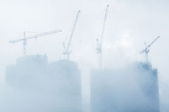 Air pollution scenic with construction plant. In mist royalty free stock photo