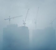 Air pollution scenic with construction plant. In mist stock images