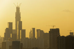 Air pollution scenic in. Countryside with building and yellow smoke in hong kong city at sunset stock photo