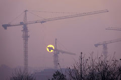 Air pollution. The serious air pollution envelop building site in the sunset royalty free stock photos