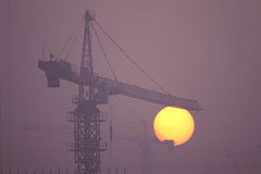 Air pollution. The serious air pollution envelop building site in the sunset stock photos