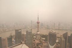 Air pollution of Shanghai politics China. Late afternoon, view of the pollution from  Shanghai landmark building Pearl TV Tower Royalty Free Stock Photography