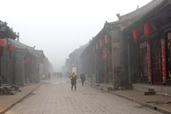 Air pollution and serious smog problems, an issue in the walled city of Pingyao (Unesco), China. Air pollution and smog are a big problem in China. This is the Royalty Free Stock Images