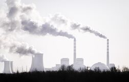 Air pollution by smoke coming out of from factory`s chimneys, Industrial zone