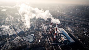 Air pollution by smoke coming out of two factory chimneys. Aerial view Royalty Free Stock Photo