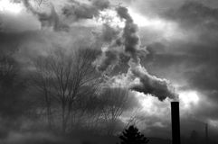 Factory. & smokestacks near a forest / natural area Royalty Free Stock Photos