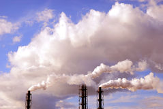 Air pollution. Pollution spewing into the air from industrial chimneys Royalty Free Stock Photos