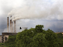 Air Pollution from Thermal Power Plant. Environmental pollution by ash particle emission from Chimney Royalty Free Stock Photos