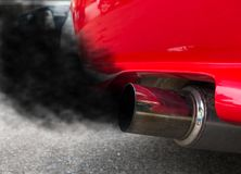 Air pollution from vehicle exhaust pipe stock photo