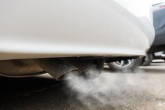Air pollution from vehicle exhaust pipe.  Stock Photo
