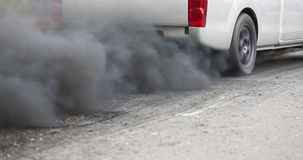 Air pollution from vehicle exhaust pipe Royalty Free Stock Image