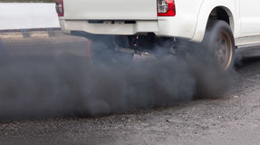 Air pollution from vehicle exhaust pipe Royalty Free Stock Images