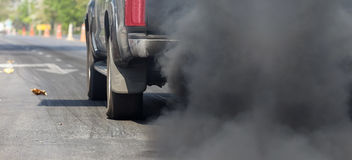 Air pollution from vehicle exhaust pipe Royalty Free Stock Photo