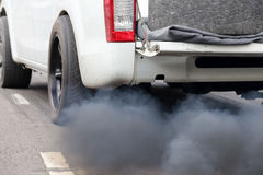 Air pollution from vehicle exhaust pipe on road Royalty Free Stock Image