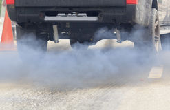 Air pollution from vehicle on road. Stock Image