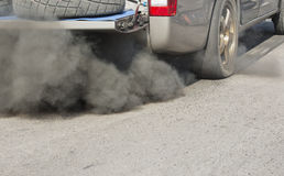 Air pollution from vehicle on road Stock Photo